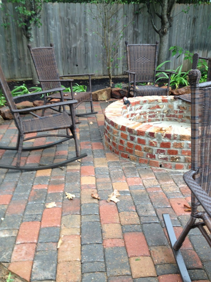 Cindy Mcclimans  Petal Organic landscaping  reclaimed birck open firepit with tumbled paver patio edged and moss rock