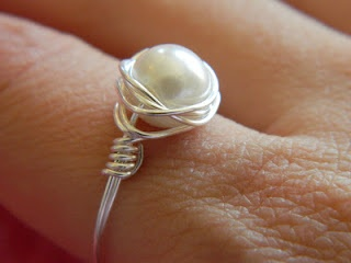 Tutorial on making a wire wrap ring. Looks pretty easy. Would make nice gifts for a little. I think I know what I'm gonna do for Noodie for her upcoming bday (or at least try if I can get to Hobby Lobby before Saturday)
