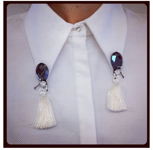 Tasseled collar clips.