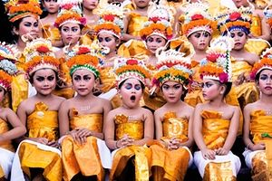 Image was taken in Bali during Melasti Festival. This Festival is conducted once a year in conjunction with Nyepi or Silent Day. These young girls were waiting for their turn to perform. They looked stunning with their bright coloured costumes and heavy make-up on, however the expression on each of the girls' face especially the yawning girl gives this image an extra 'ummpph'