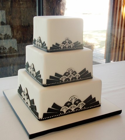 art deco wedding cakes. The simplicity is nice, so many Art Deco cakes are so elaborate and kinda gaudy.