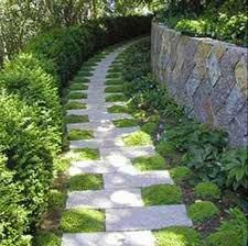 What an imaginative walkway. Staggering stepping stones with patches of plush grass to fill the void.