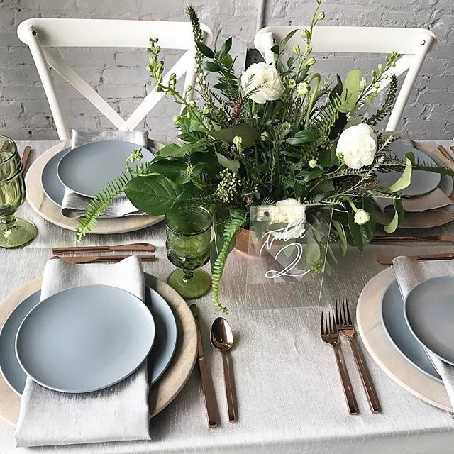 Driftwood chargers, green glassware, #rosegold cutlery & acrylic table numbers - soft, feminine and very easy on the eye. We #love this fresh #weddingtabledecor  Venue: @haus820  Flowers & Design: @amberveatchdesigns  Driftwood chargers: @set_rentals  Lin