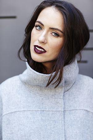 Sigourney wears MAC Lip Liner in Vino and MAC Lipstick in Media. Coat by Max Mara.