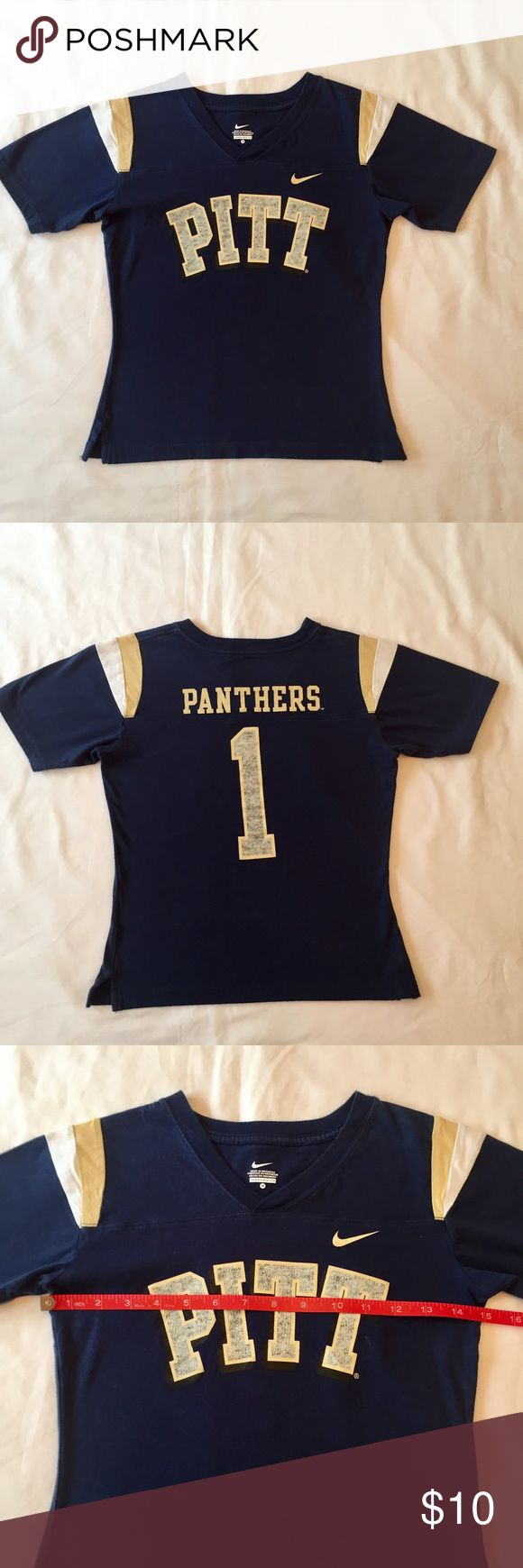 PITT UNIVERSITY OF PITTSBURGH GIRLS SHIRT FOOTBALL Go Pitt!  Really great condition on this little girls NIKE BRAND Pitt Football T-Shirt!  Size medium, please see pictures for more measurements.  No material tag, soft and stretchy. Cool sweater pattern on the Pitt and number 1 prints.  Freshly laundered and pressed.  Free of smoke and pets.  NCMCOLLECTIONS 💐 Nike Shirts & Tops Tees - Short Sleeve