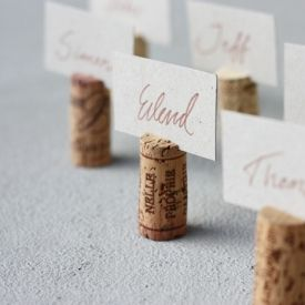 Let your guests know where to sit with homemade cork name tags or label foods on a buffet table.
