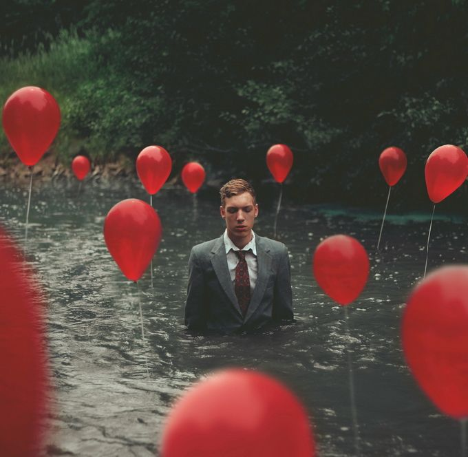 interesting use of balloons, and combo with guy in suit.