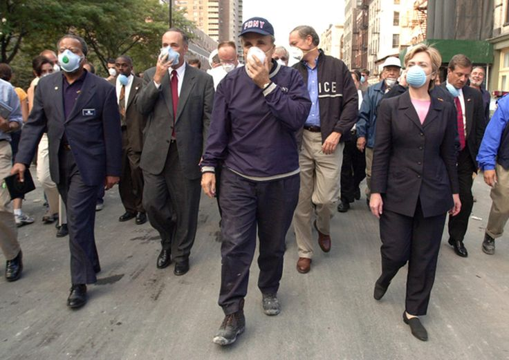 9/11 New York City Mayor Rudolph Giuliani (center) leads New York's Senators Charles Schumer and Hillary Clinton and New York Governor George Pataki on a tour of the site of the World Trade Center disaster September 12, 2001 in New York.