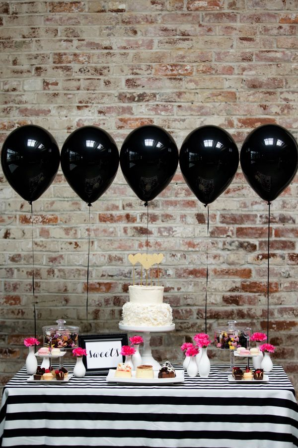 Black balloons and a black and white striped tablecloth make for beautiful desert table decor!