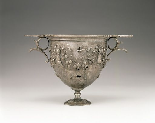 This early (1st century B.C.) Roman chalice depicts four cupids, garland, birds, and other items associated with the Roman god Bacchus. These kinds of themes were very prevalent during Roman gatherings between the late first century B.C. into the early first century A.D.