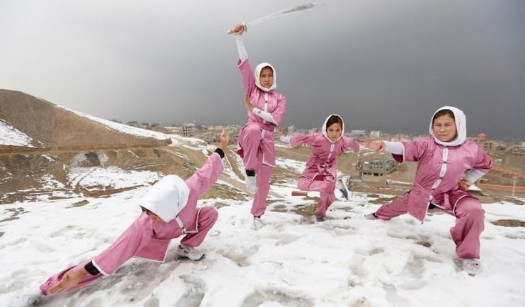 shiroshakar:  salamalaikum:  On a snowy mountaintop to the west of Kabul a group of Afghan girls practice the flowing movements of Wushu a sport developed from ancient Chinese kung fu martial arts stretching and bending and slashing the air with bright swords. (REUTERS/Mohammad Ismail)  I just read the article about these women and Im thrilled