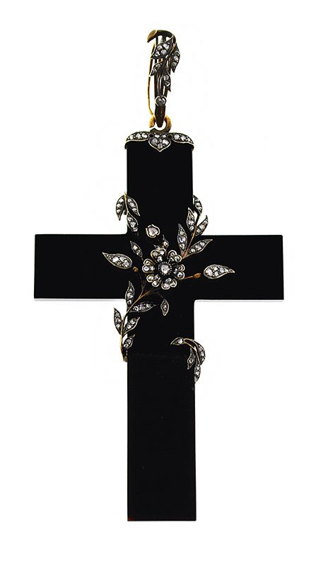 Black Cross Pendant Wrapped in Diamond Vines. This incredible Georgian large cross pendant has a beautiful flowering vine motif with rose cut diamonds. The silver metal work is set with a total of 115 diamonds and the affect of the rose cuts in the design is dazzling. The pendant hangs from a genuine antique gold chain.