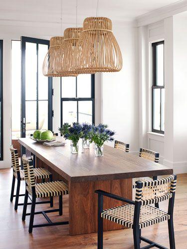 For beachy boldness, designer Sally Markham lit the dining table with rattan Orbita pendant lamps by Tomoko Mizu.