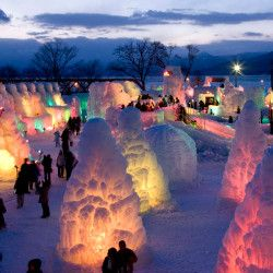 """The """"Sapporo Snow Festival"""" is held in three sites in the Sapporo city, including Odori Park. In addition to giant, building-like snow sculptures as high as 15m, there are also slides and skating rinks. It is an event unique to the North of Japan, where you can have fun with the ice and snow."""