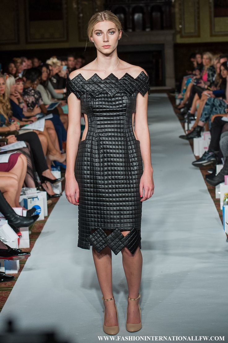 Lenie Boya Spring/Summer 2015 Haute Couture. Futuristic, fabric Manipulated black dress, with 3D cubist details.