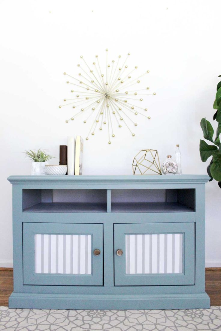 This painted TV stand is easy to replicate and if you want to paint furniture, this post has the best paint to use and tips for how to prep!