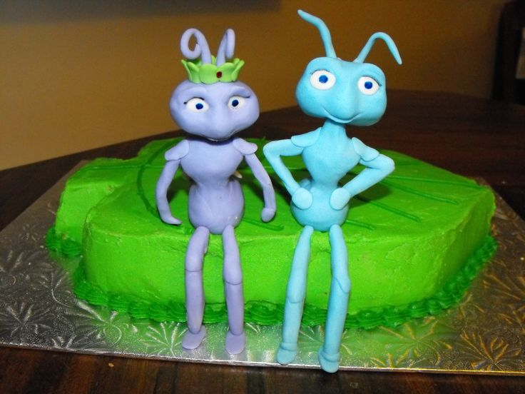 A Bug's Life Cake is a leaf shape (carved from a 9 x 13). Flik and Princess Atta are made from modelling chocolate, covered in fondant...