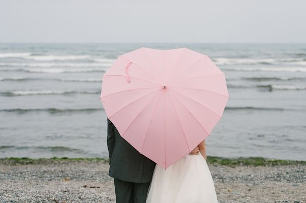 Under the heart shaped umbrella. Aw.