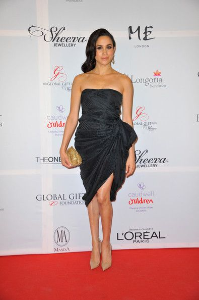 Meghan Markle Strapless Dress - Meghan Markle chose a draped black strapless dress for a classy red carpet look during the London Global Gift Gala.