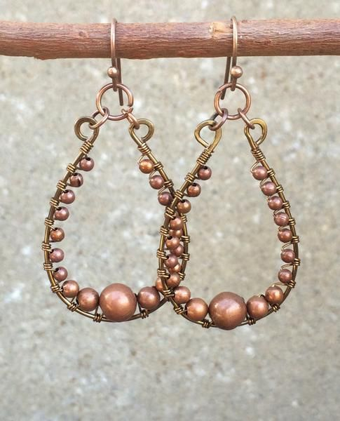 """Wire wrapped copper hoop earrings with graduated sizes of antiqued copper beads. Approx 2"""" in length and very light weight."""