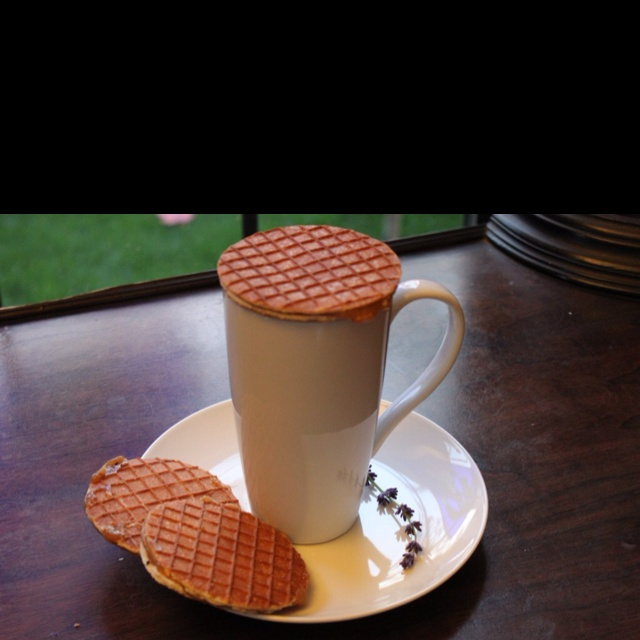 """The Stroopwafel – or """"syrup waffle"""" – is a traditional Dutch cookie originating from Gouda in the Netherlands. No one is certain when people began baking them; one story dates the first stroopwafel in 1784. A baker made cookies out of crumbs from his left over baked goods and put the warm syrup between the cookies. The first known recipe for Stroopwafels dates back to 1840.  Traditionally, Stroopwafels are placed on your coffee cup to heat them through. The steam from the coffee heats and…"""