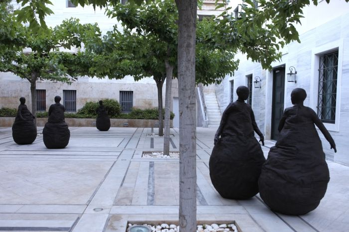Installation View | A Thousand Doors, The Gennadius Library, Athens, May – June 2014  Juan Munoz, Conversation Piece II, 2001  Bronze in six parts  Courtesy the Estate Juan Muñoz © Photographer NataliaTsoukala