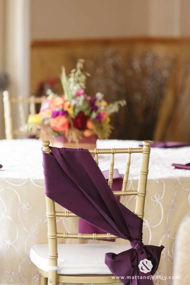 Eggplant purple sash tied into a pretty little bow is a lovely touch to any table scape