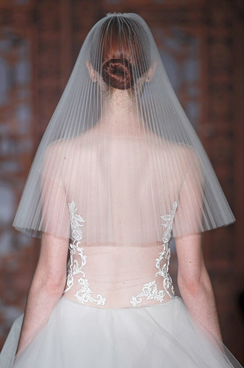 A tight bun under the bride's veil at Reem Acra, Fall 2013 runway show
