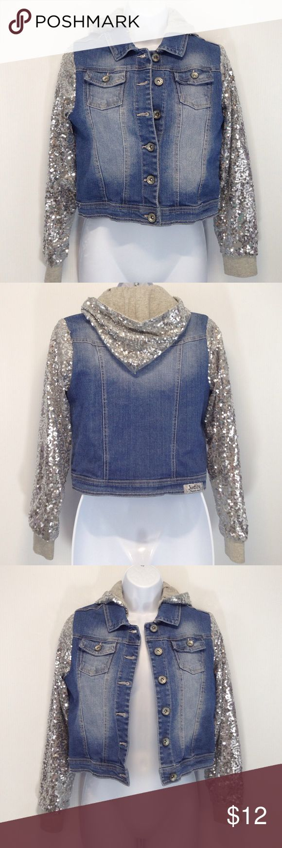Sz 14 Justice Silver Sparkle Jean Jacket Hoodie Super cute Justice Jean Jacket with sparkly silver sleeves on a sweatshirt material for both the sleeves and hood. The Jean Jacket portion is whispered or lightened in certain areas purposefully. The jacket is in terrific condition. It is a size 14 girls. Justice Jackets & Coats Jean Jackets