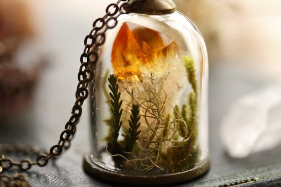 A stunning raw Citrine crystal has been nestled into a bed of real Irish woodland mosses and lichens under a tiny glass bell-jar to make this magical handmade terrarium necklace. This intricate terrarium pendant reminds me of the mountainsides of Kerry, where I used to love spending hours exploring the banks around my home, hunting for tiny quartz crystals. This miniature diorama is the perfect piece of nature to carry with you and remind you of where your heart belongs. It would be such a…