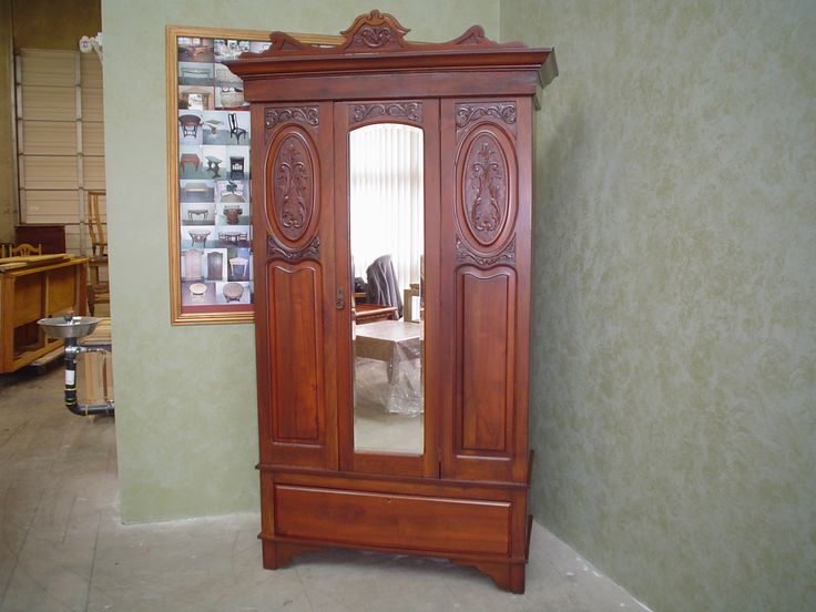 Armoire- repaired and refinished by AM Furniture Finishing.