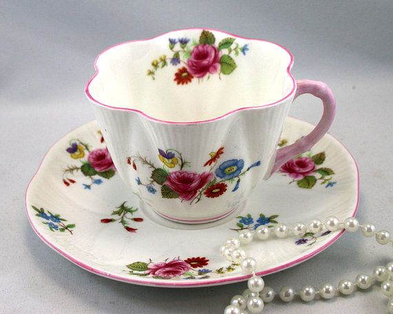 Shelley, Vintage Teacup & Saucer, Delicate Floral Pattern, Pink Edges,Dainty Shape, Fine English China made in 1930s In perfect condition, no chips, cracks, crazing or repairs. The Saucer measures-5.7 (14.5cm) in diameter. The Cup opening-3.1 (8cm), with the handle-4 (10cm) The