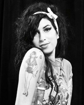 I LOVE this picture of her..a rare but confident, pleased, and beautiful Amy likely thinking she's finally achieved her lifelong dreams. Tragically, those achievements  were halted with her death, but thankfully not her music and her memory.