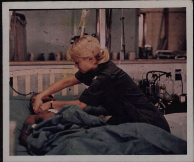 Location- Pleiku, Vietnam.  Photogrpaher- SP4 [Aos].  2LT Leslie E. Taylor (Southington, Connecticut), administers to a patient in the Intensive Care Ward at the 71st Evacuation Hospital