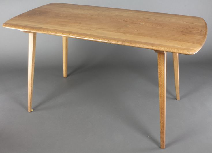 "Lot 887, Ercol, a light elm rectangular dining table, raised on out swept supports together with 2 extensions 29""h x 53""l x 28""w, with the 2 extensions added and in place the length of the table is 90"",  labelled supplied by John Peering, sold for £220"