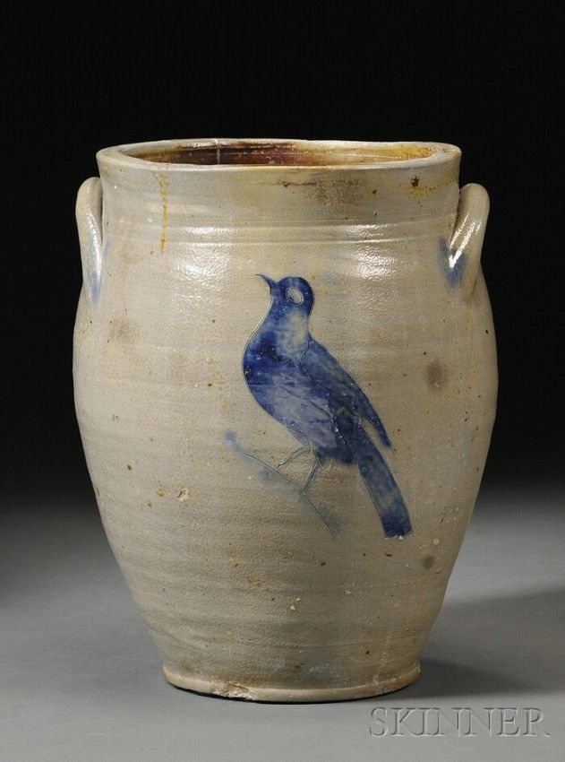 William Capron Stoneware Jar with Incised Cobalt Flower and Bird Decoration, Albany, New York, c. 1800-05, oval jar with reeded neck, applied lug handles with cobalt daubed terminals, the front and back decorated with incised cobalt blue decoration, one side depicting a flower blossom, the other a bird, ht. 13 3/8 in.