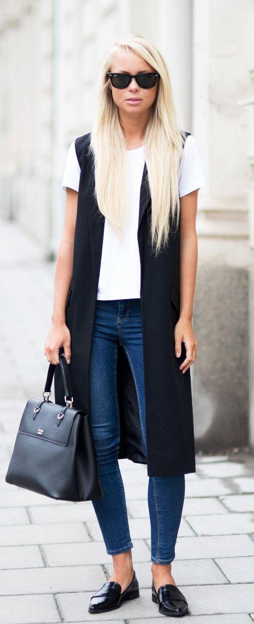 Sleeveless Jacket Trend: Victoria Tornegren is wearing a black Asos sleeveless…