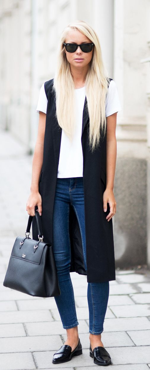 Sleeveless Jacket Trend: Victoria Tornegren is wearing a black Asos sleeveless…
