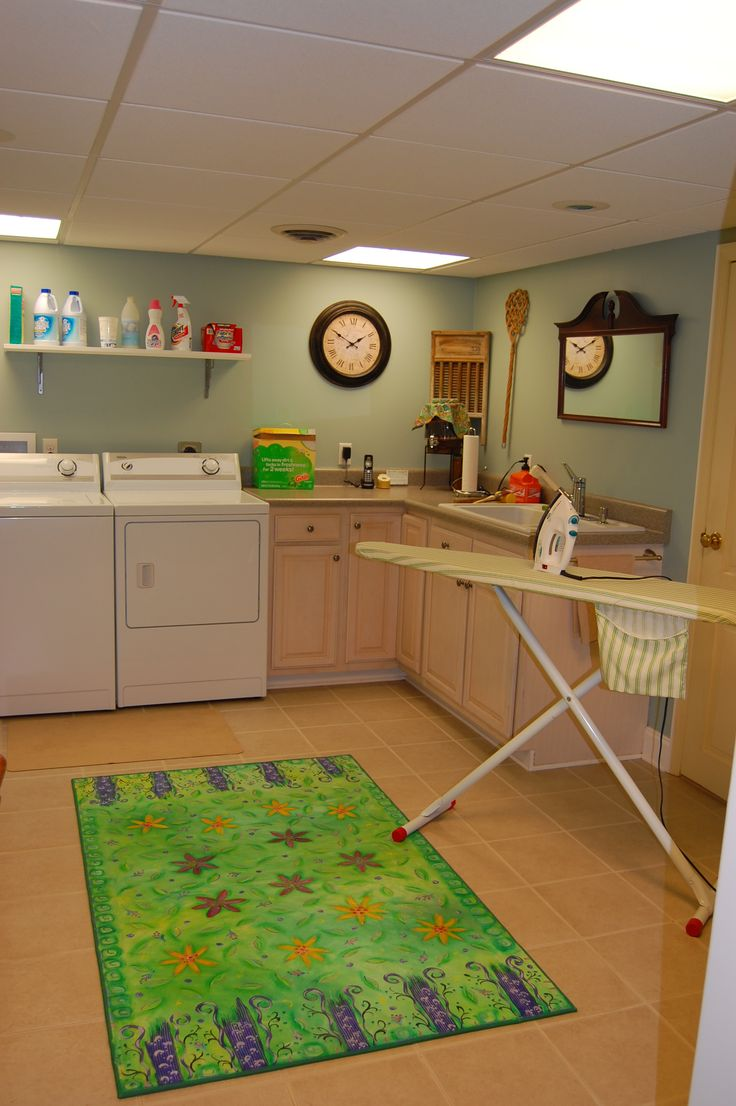 """""""Flowers and Stripes"""" Floorcloth in the laundry room."""