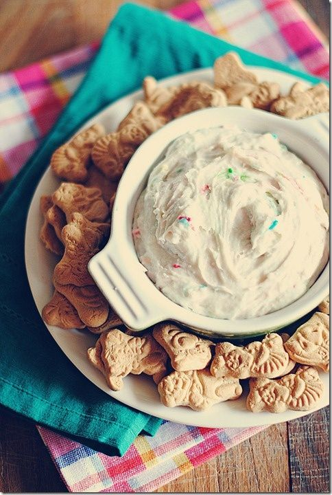I'm having fat kid flashbacks: Dunkaroo Dip-1 box funfetti cake mix, 1/2 container plain yogurt, 1/2 container of whip cream.. Serve with animal crackers, graham crackers, or teddy grahams.