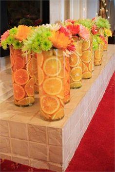 Summer centerpieces orange green yellow with fresh fruit Orlando wedding flowers / http://www.weddingsbycarlyanes.com