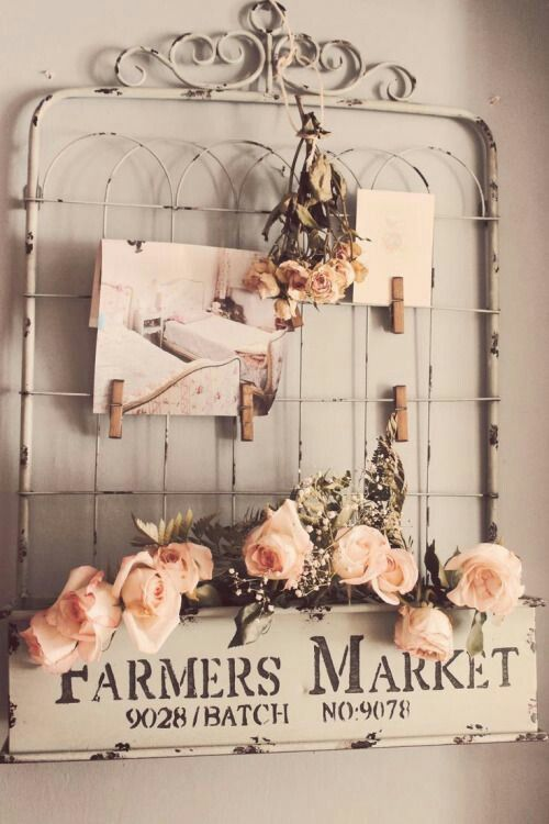 Wire rack, clothespins, roses, farmers market sign