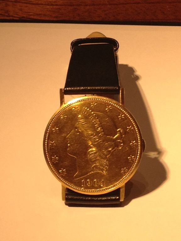 PIAGET Yellow Gold Twenty Dollar Coin Wristwatch | From a unique collection of vintage wrist watches at https://www.1stdibs.com/jewelry/watches/wrist-watches/