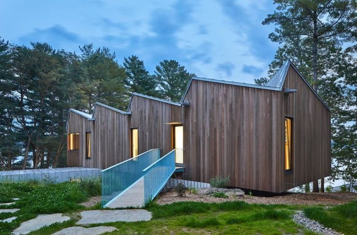 A striking sawtooth roof tops this net-zero lake house in Canada