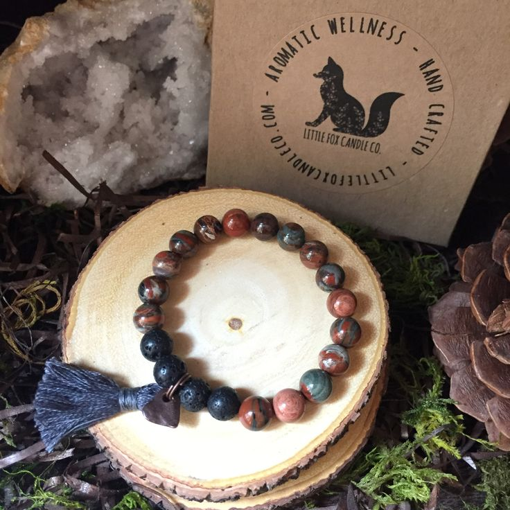 """Little Fox Gemstone Diffuser Bracelet: (Firework) Jasper  is known as the """"supreme nurturer"""". A stone of gentleness, comfort, and relaxation. Balances yin/yang energies. Red jasper is associated primarily with the root chakra but also with the sacral chakra."""