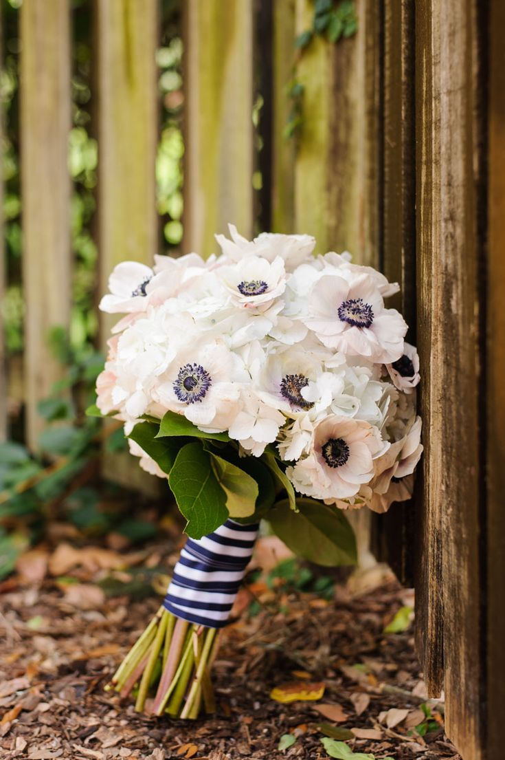 Bridal bouquet with white anemone flowers. - The Celebration Society