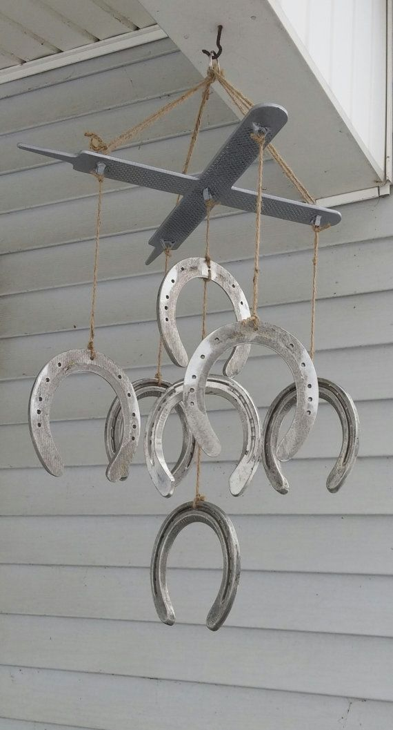 Check out this item in my Etsy shop https://www.etsy.com/listing/269918101/horseshoes-and-rasps-wind-chime