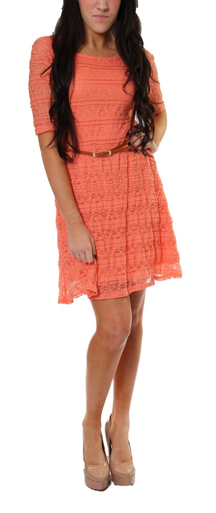 This great dress in coral haze by Jolt features an orange lining with a coordinating lace overlay. The sheer sleeves and brown skinny belt give this dress a trendy look that makes it perfect for spring and summer!