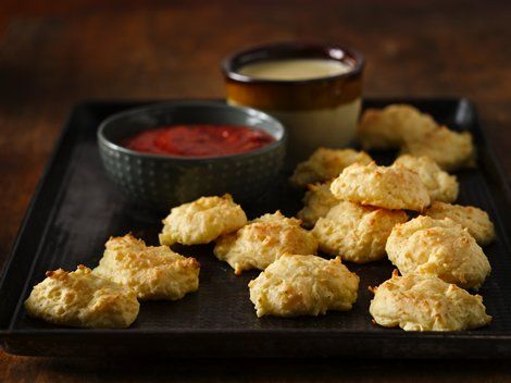 Cheddar-Parmesan Puffs with Dipping Sauces - Bake these cheesy appetizers made using Progresso™ Recipe Starters™ cheese sauce and Bisquick® mix – perfect for a crowd.