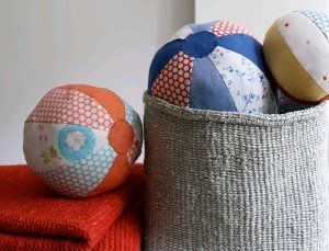 Fabric Beach Balls.  USAV has a pattern for fabric cover balloons in the size of a volleyball that I have the pattern for.  These look similar.
